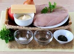 как приготовить Отбивные в духовке с помидорами и сыром