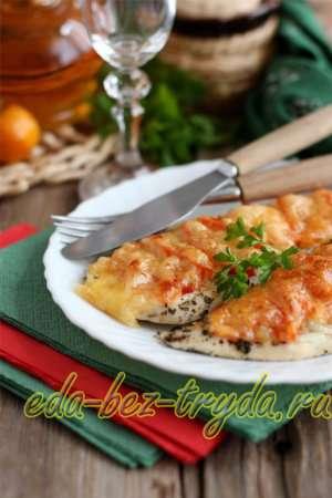 Отбивные в духовке с помидорами и сыром готовы